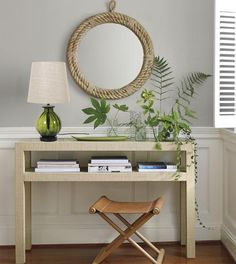 raffia console with Cooper Leather StoolCooper Leather Stool Entryway Decor, Entryway Tables, Entryway Ideas, Console Tables, Table Lamps, Foyer Furniture, Lacquer Furniture, Wooden Console, Table Mirror