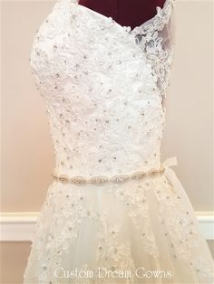 Stunning Crystal Beaded Lace #Wedding Dress by Custom Dream Gowns! Lace on Tulle Over Satin A-Line Wedding Dress Featuring a Sexy Sweetheart Neckline, Beaded Lace Tank Straps, Beaded Lace Fitted Bodice with a Crystal Belt at Natural Waistline, Beaded Lace Applique Through Tulle A-Line Skirt, Court Train, Illusion Lace High Back Over Low V-Back Interior with Covered Buttons Over Hidden Zipper. #gorgeousweddingdress #bridalgowns #weddingdresses #laceweddingdress #aline #sweetheart…