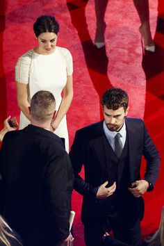 """Shailene Woodley Photos Photos - Theo James and Shallene Woodley attend the World Premiere of """"Insurgent"""" at Odeon Leicester Square on March 11, 2015 in London, England. - 'Insurgent' Premieres in London"""