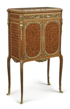 Attributed to François Linke A Louis XVI style gilt bronze mounted satinwood and amaranth woven parquetry cabinet France, late 19th century surmounted by a brèche violette d'Espagne marble top, spring-released frieze drawer above doors opening to two shelves, the lock stamped DUVIVIER/PARIS/77 Fg. St. ANTOINE
