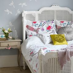 Summer floral bedroom This grey pastel bedroom teams white stencilled birds and a vintage cane bed with summery chic bedding and colourful bird motifs for a calming look. Summer Bedroom, Home Bedroom, Bedroom Decor, Bird Bedroom, Bedroom Ideas, Bedroom Designs, Master Bedroom, Gray Bedroom, Bedroom Inspiration