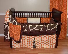 Sweet Potato Giraffe Crib Set  Included in this custom baby crib bedding set is the  bumper pad, chocolate minky backed blanket, and box pleat polka dot crib skirt.The orange, cream, and chocolate make this bedding perfect for boy or girl!