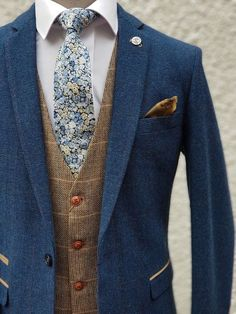 Marc Darcy Dion blue tweed suit with Marc Darcy Ted Tan waistcoat and Liberty London Chive Blue Gold Cotton Tie suits men Blue brown men's tweed suits Blue Tweed Wedding Suits, Blue Tweed Suit, Mens Tweed Suit, Vintage Wedding Suits, Tweed Vest, Tweed Groom, Vintage Groom, Rustic Wedding Suit, Men's Waistcoat