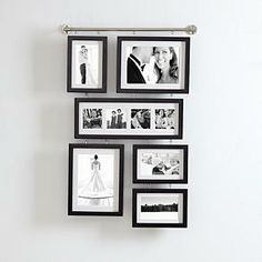 Another great found item project! A decorative curtain rod, screw in eye hooks, frames and you have an instant eye catching photo frame display! You could even spray paint the frames to match your decor and the frames don't even have to match. This would be so cute with mis-matched frames!