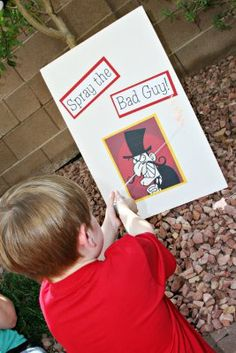 super hero party: Spray the Bad Guy (instead of Pin the Tail on the Donkey). Creative!