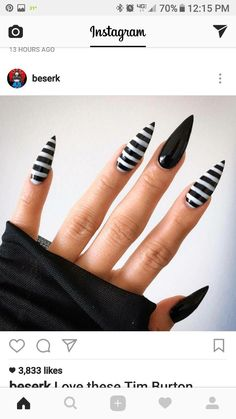 Black and white striped stiletto nails #stilettonails