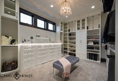 Hers master closet with white cabinet and custom dresser with Lucite pulls.  Sita Montgomery Interiors – Cameo Homes Inc.