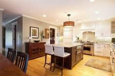 Great white cabinets and gray subway tile back splash.