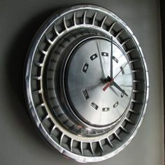 Not only does this old hubcap look cool but it has found a new purpose in life – keeping time.  I think this would make an awesome gift for any car or truck fanatic. I can just imagine it hanging in a shop, man-cave or office.