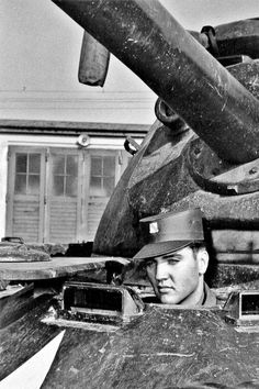 Elvis Presley in the drivers seat of a tank in Germany, 1958.