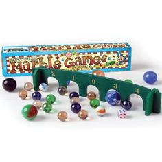 Learn some traditional marble games of skill and have fun as a family. This set of marble games comes with a wooden archboard, dice, instructions + marbles. Marble Games, Wooden Arch, Fun Games, Games Box, Traditional Games, 9 Year Olds, Old Toys, Miniatures, Marbles