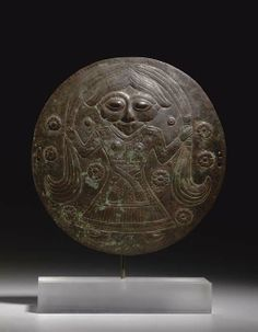 A LURISTAN BRONZE DISK - CIRCA 900-700 B.C.