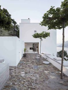 Wespi De Meuron Romeo Architects designed a minimalist house in Brissago, Switzerland, featuring all-white, meditteranean terraces with stunning views over lake Maggiore.