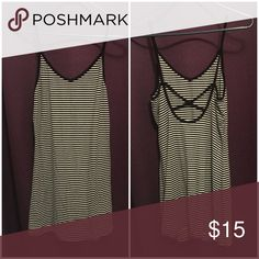 Striped dress with open back cute striped dress with open back!  brand new condition.  it's super cute,  I just don't wear it a lot   NOT Brandy Melville-   just using for exposure Brandy Melville Dresses Backless