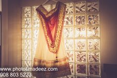 Bride's dress, lengha in Fusion Wedding at Sheraton Eatontown. Best Wedding Photographer PhotosMadeEz. Award Winning Photographer Mou Mukherjee. Event coodrinated by Social Life Events #reddy4ever Fall theme.