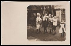 CHILDREN PLAYING  LONDON BRIDGE  GAME REAL PHOTO POSTCARD