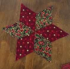Dress up your dining table, coffee table or side table with this beautiful star table topper. It is the perfect size for displaying a candle, holiday flowers or a candy dish. It is reversible.  It is machine washable using a delicate cycle and cold water.  This star candle mat measures approximately 15.25 inches from point to point. It was made by me in my smoke-free home.  This listing is for one Star candle mat only. Thanks for looking