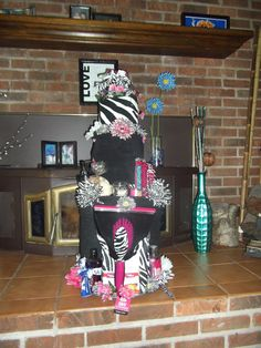 Towel cake. Pink & Zebra Themed. Wedding shower present!!! This cake was kind of big. it had around 8-9 or so towels on the bottom, 6 hand towels, a set of dish towels in the center layer. and 10 wash clothes for the top layer. The main top layer was a bath and body works zebra print candle holder filled with b bulbs... plus all the extra's you see.