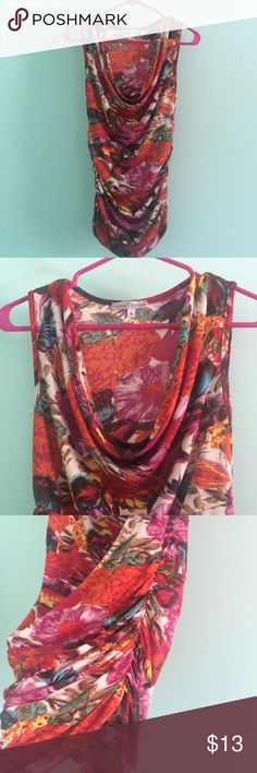 Colorful Blouse Droop neckline, sleeveless, scrunched on the sides. Spandex and polyester mix. Tops Blouses