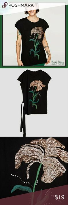 Zara Crystal Embellished Side Tie Tunic Top Zara Crystal Embellished Flower Tunic Top with Grosgrain Ribbon Ties at the Hip.  100% cotton exclusive of decoration.  Lenght is approximately 26 inches (S) and approximately 27 inches (M).  New with tags. Zara Tops Tunics