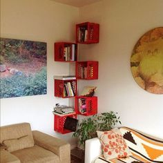 A floating corner bookshelf made from milk crates. http://hative.com/diy-ideas-with-milk-crates-or-wooden-crates/