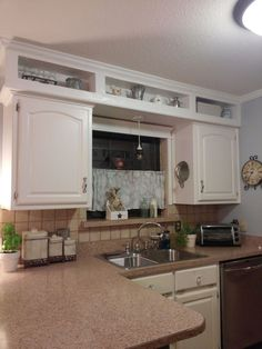 Kitchent Cabinets Makeover from outdated soffits to usable space, kitchen cabinets, kitchen design, shelving ideas, storage ideas - This transformation is UNBELIEVABLE! Kitchen Soffit, Above Kitchen Cabinets, Modern Kitchen Cabinets, Painting Kitchen Cabinets, Kitchen Paint, New Kitchen, Kitchen Decor, Space Kitchen, Decorating Kitchen