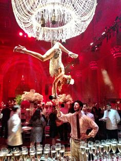 aerialist pouring champagne -