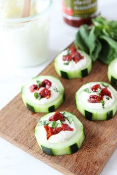 Cucumber Canapés with Whipped Feta, Sun-Dried Tomatoes and Basil on twopeasandtheirpod.com