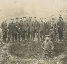 German WW1 Photograph - Soldiers near a Shell Hole.