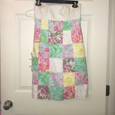 Lilly Pulitzer summer dress Strapless dress with white top and colorful patchwork body of the dress. Very beautiful for summer looks great with a tan Lilly Pulitzer Dresses Strapless