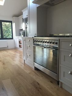 Kitchen cupboards in Dulux heritage Chiltern White with Smeg duel fuel stainless steel range cooker