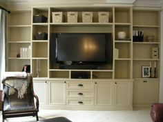 rooms with built in shelves for tv | Built-In Entertainment Unit and Fireplace Surround w/Antique Barn Beam ...