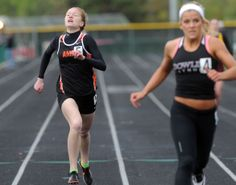 Ames' Ryan Weiss finishes the girls' 400- meter run in the district meet at Ankeny Stadium on Thursday, May 15. Photo by Nirmalendu Majumdar/Ames Tribune