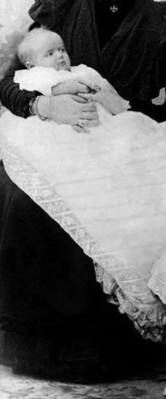 The Grand Duchess Maria Nicolaevna Romanova, 3rd daughter of Tsar Nicholas II and Empress Alexander. Here, she is held by her mother The Empress.