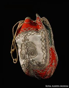 This reticule from the Southesk collection is made of wool cloth, metallic thread and hide lining. The reticule was a European fashion accessory of the early 1800s, some women used it to hold sewing equipment. | Royal Alberta Museum