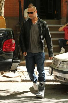 Derek Jeter steps out in Manhattan Thursday with a protective boot on his left ankle