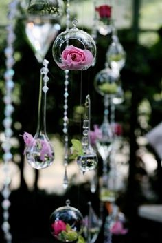 crystals, candles, and flowers hanging in trees or above dance floor. pretty!