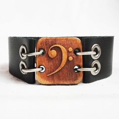 Bass Clef / Music / Musician / Leather Bracelet / Cuff Bracelet by GiftsGraceGratitude on Etsy https://www.etsy.com/listing/246891668/bass-clef-music-musician-leather