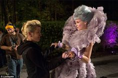 Elaborate: Elizabeth Banks reprises her role as the ornately dressed Capitol District 12 escort Effie Trinket