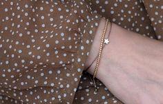 Zierliches #Textilband in #Taupe Farbe mit kleinen 2,2 mm vergoldeten Kügelchen aus 925 Silber. Für einen trendigen #Look einzeln oder mit mehreren #Armbändern kombinierbar. Das Armband besitzt einen #Knotenverschluss für verstellbare Länge. Ein einzigartiges #handgemachtes #Schmuckstück für dich. Designed by Schoschon. Hier erhältlich->  http://www.schoschon.de/deta…/index/sArticle/269/sCategory/9