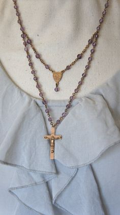 Vintage rosary bead necklace.  I usually don't like rosary beads as jewelry, but this one seems serene and respectful.