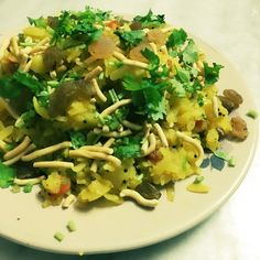Batata Poha. Flatten Rice cooked with Potato.