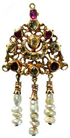 An 18th century Indian gold rose diamond and ruby pendant of pierced floral design with natural pearl drops, 3in overall length.