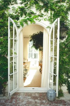 vines and rounded french doors from bedroom