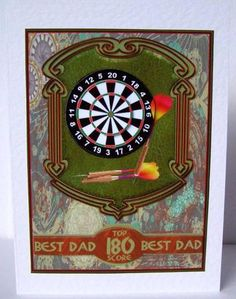 A dart board and arrows set on a leather panel on a steampunk background, with matching sentiment wrap.  Three levels of dartboard pyramid with sentiment options for wrap including Best Dad and various male birthday options.