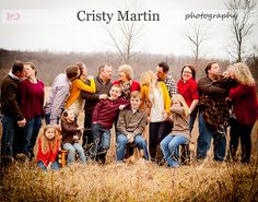 Large family picture. Love the vibrant  color of clothes against the wheat colors. Love them being goofy Too!