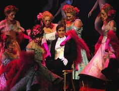 David Hobson (and gorgeous Grisettes) in Opera Australia's The Merry Widow.  Designed by Leslie Travers.