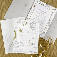 Winter weddings or holiday party invitation idea features silver and gold stars and swirls. Have your friends and family celebrate the new year with you by sending them this New Year's invitation.  NAN5736-93