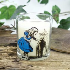 Scented Candle http://paladone.com Accessorise your room with this gorgeous, vanilla-scented candle. Measuring 8 cms in diameter and 9 cms in height, the candle is contained within a glass featuring an original illustration of Alice and a quote from the book. #paladone #gifts #design#innovation #invention #toys #giftware #aliceinwonderland #wonderland #throughthelookingglass #scentedcandle #candle #tealight