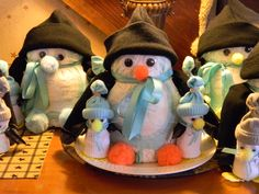 Penguins made from diapers for centerpieces for a baby shower for twins